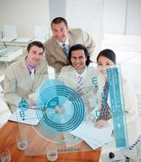 Overview of happy colleagues using blue chart interface - stock photo