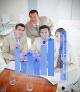 Overview of cheerful colleagues using blue chart interface - stock photo