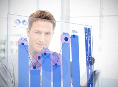 Businessman looking at blue chart interface - stock photo