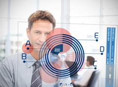Businessman looking at blue diagram interface Stock Photos
