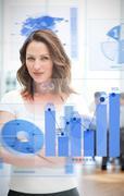 Confident blonde businesswoman using chart interfaces Stock Photos