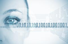 Close-up of eye of woman with futuristic background Stock Photos