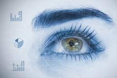 Close up of woman eye analyzing chart interfaces - stock photo