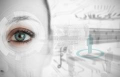 Close up of woman eye with futuristic interface - stock photo