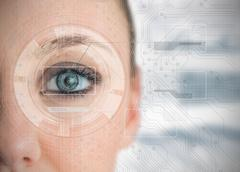 Close up of woman eye analyzing charts Stock Photos