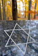 Graniitti laatta, jossa juutalainen tähti Kuvituskuvat