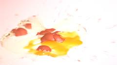 Egg smashing on white surface Stock Footage