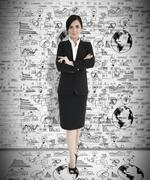 Attractive businesswoman with arms folded Stock Photos
