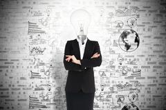 Businesswoman and light bulb - stock photo