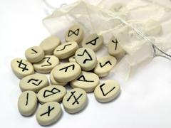 nordic runes wtih small bag - stock photo