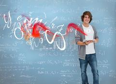 Student posing in front of chalk board - stock photo