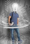 Student with light bulb head standing against circuit board background Stock Photos