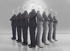 Business team with light bulb heads - stock photo