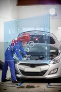 Mechanic with open hood with futuristic interface Stock Photos
