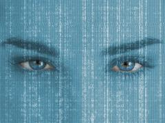 Attractive blue eyed woman with matrix on face - stock photo