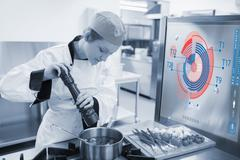 Chef cooking for a restaurant with futuristic interface - stock photo