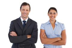 Smiling co workers standing next to each other - stock photo