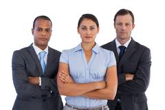 Stock Photo of Group of serious business people standing together
