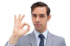 Serious businessman showing ok sign Stock Photos
