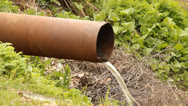 Pipe with flowing water Stock Footage