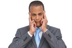 Stock Photo of Businessman putting his fingers on his temples