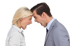 Colleagues quarreling head against head Stock Photos