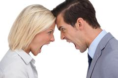Stock Photo of Colleagues shouting against each other