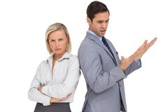 Blonde businesswoman angry against her colleague arguing Stock Photos