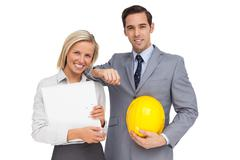 Architects with plans and hard hat Stock Photos