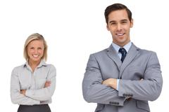 Smiling business co workers standing together - stock photo