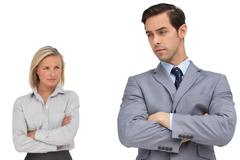 Young business people standing together showing rivalry Stock Photos