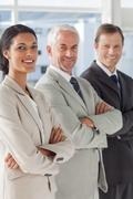 Stock Photo of Three smiling business people standing together