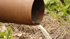Pipe with flowing water - stock footage