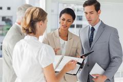 Business people making an appointment - stock photo