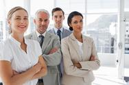 Stock Photo of Smiling business people standing together