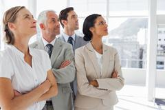 Stock Photo of Business people looking at the same way