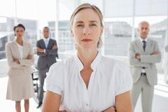Stock Photo of Serious businesswoman standing with arms folded