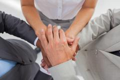 Business people gathering their hands together - stock photo