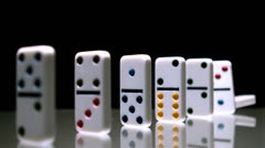 Dominoes toppling over Stock Footage