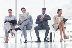 Waiting room with business people - stock photo