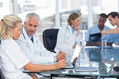 Two doctors using laptop Stock Photos