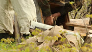 The apiary. Spring works with hives Stock Footage