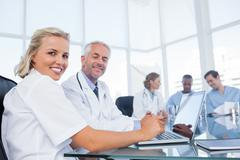 Two doctors smiling - stock photo