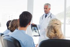 Stock Photo of Doctor presenting x-ray
