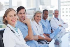 Medical team sitting in row Stock Photos