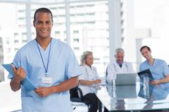 Stock Photo of Doctor holding file