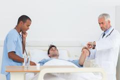 Doctors examining a patient Stock Photos