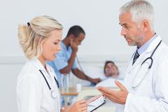 Doctors speaking together about the patient - stock photo