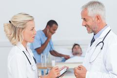 Smiling doctors speaking together Stock Photos