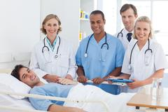 Stock Photo of Medical team and patient smiling